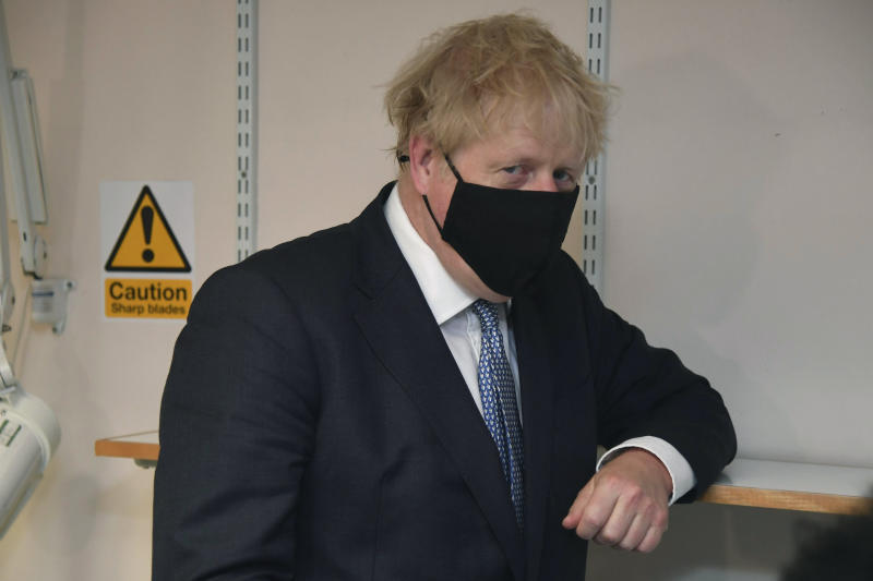Britain's Prime Minister Boris Johnson gestures during a visit to Tollgate Medical Centre in Beckton, East London, Friday July 24, 2020. (Jeremy Selwyn/Pool Photo via AP)