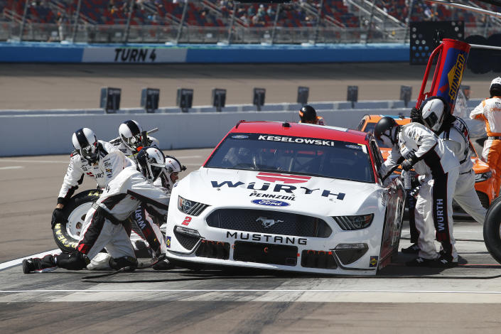 Brad Keselowski makes a pit stop for fuel and tires during a NASCAR Cup Series auto race at Phoenix Raceway, Sunday, March 14, 2021, in Avondale, Ariz. (AP Photo/Ralph Freso)