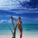 <p>Newlywed Hailey Bieber led the model pack in this season's biggest swimwear trend – neon snake print. <em>[Photo: Instagram]</em> </p>