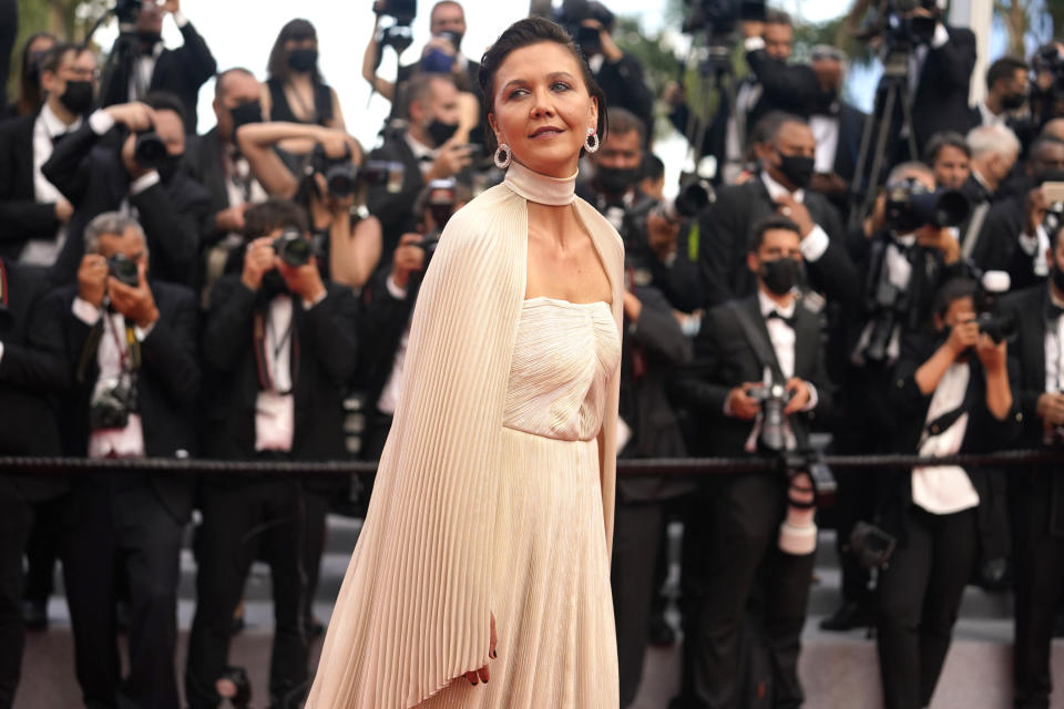 Maggie Gyllenhaal poses for photographers upon arrival at the premiere of the film 'Annette' and the opening ceremony of the 74th international film festival, Cannes, southern France, Tuesday, July 6, 2021. (AP Photo/Brynn Anderson)