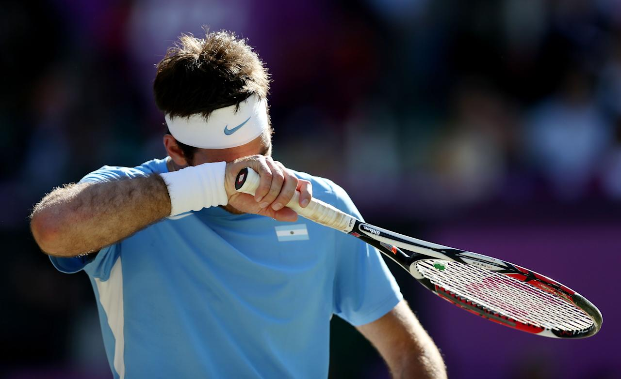 LONDON, ENGLAND - AUGUST 03:  Juan Martin Del Potro of Argentina reacts while playing against Roger Federer of Switzerland in the Semifinal of Men's Singles Tennis on Day 7 of the London 2012 Olympic Games at Wimbledon on August 3, 2012 in London, England. Federer defeated Del Potro 4-6, 7-6, 19-17. (Photo by Clive Brunskill/Getty Images)