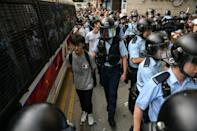 Some young pro-democracy supporters were seen being detained outside and inside the mall by police