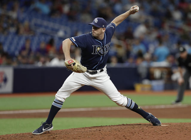 Tampa Bay Rays relief pitcher Adam Kolarek delivers to the Boston Red Sox during the eighth inning of a baseball game Wednesday, July 24, 2019, in St. Petersburg, Fla. (AP Photo/Chris O'Meara)