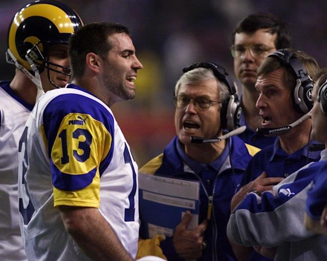 Head coach Dick Vermeil (middle) and the St. Louis Rams rode Kurt Warner's arm all the way to a Super Bowl title in the 1999 season.  (AP)