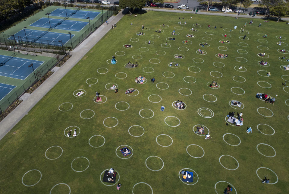 SAN FRANCISCO, CA - MAY 21: People utilize social-distancing circles at Dolores Park in San Francisco, Calif., on Thursday, May 21, 2020. The Parks and Recreation Department painted the circles in the northernmost area of the park, but other areas have not been painted. (Jane Tyska/Digital First Media/East Bay Times via Getty Images)