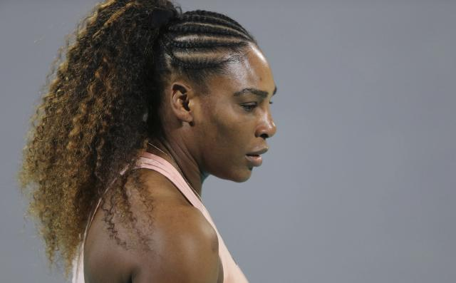 Serena Williams from the U.S. reacts during a match against her sister Venus, on the opening day of the Mubadala World Tennis Championship in Abu Dhabi, United Arab Emirates, Thursday, Dec. 27, 2018. (AP Photo/Kamran Jebreili)