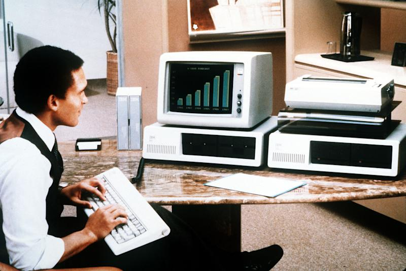 FILE-In this undated file photo, a man tries out the enhanced version of International Business Machines Corp's Personal Computer which was unveiled in New York, March 8, 1983. The PC business is faltering amid shifting technology trends since Apple Inc. shifted the direction of computing with the release of the iPhone in June 2007.  HP's market value has plunged by 60 percent to $35 billion, while Dell's market value has also plummeted by 60 percent, to about $20 billion. (AP Photo/File)