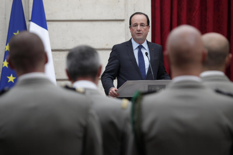 """France's President Francois Hollande gives a speech during a ceremony to honor French troops home from Afghanistan, at the Elysee Palace, in Paris, Friday, Dec. 21, 2012. Hollande has declared """"mission accomplished"""" for French combat troops who returned home recently from Afghanistan. France still has 1,500 troops in Afghanistan repatriating equipment or working in roles like providing medical care or helping run Kabul's airport. Hollande said the numbers will decline to 500 by mid-2013. (AP Photo/Thibault Camus)"""