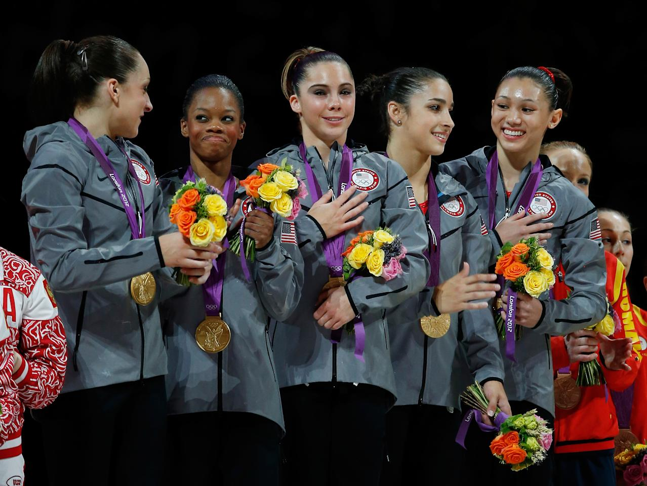 Jordyn Wieber, Gabrielle Douglas, Mc Kayla Maroney, Alexandra Raisman and Kyla Ross of the United States celebrate on the podium after winning the gold medal in the Artistic Gymnastics Women's Team final on Day 4 of the London 2012 Olympic Games at North Greenwich Arena on July 31, 2012 in London, England.  (Photo by Jamie Squire/Getty Images)