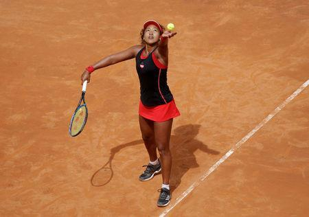 FILE PHOTO: Tennis - WTA Premier 5 - Italian Open - Foro Italico, Rome, Italy - May 14, 2018 Japan's Naomi Osaka in action during her first round match against Belarus' Victoria Azarenka REUTERS/Max Rossi