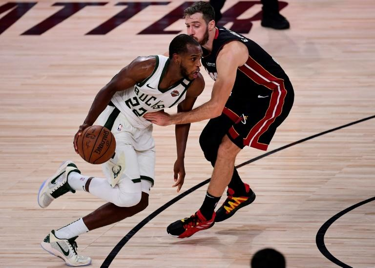 Bucks lose Giannis but beat Heat in OT to stay in NBA playoffs