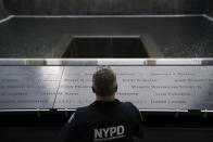 """NYPD officer Michael Dougherty, a 25-year veteran, stands beside the south reflecting pool of the 9/11 Memorial & Museum where names of his deceased colleagues and friends are displayed, Monday, Aug. 16, 2021, in New York. A close friend of Dougherty's family, Richard Dunston, worked in the towers on the day of the attacks. His body was never found. """"So every morning we'll do walk arounds on the piece of the plaza where the towers stood,"""" Dougherty said. """"If we see something on the panel we'll make sure to wipe it off, and I see their names and I'll touch them. You know, I'm here looking over them."""" (AP Photo/John Minchillo)"""
