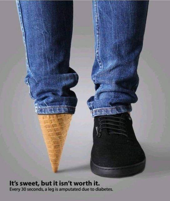 legs of person wearing jeans and one black shoe, the other foot is represented by an ice cream cone