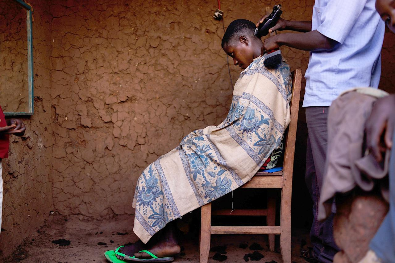 MPANDA, BURUNDI - JUNE 23: A boy gets his hair cut June 23, 2015 in Mpanda, Burundi. The head of Burundi's influential rights group, Aprodeh, says at least 70 people, mostly civilians, have been killed and hundreds of others wounded following weeks of political unrest in the small, impoverished country in the African Great Lakes region of East Africa. The violence started after President Pierre Nkurunziza announced his controversial bid for a third consecutive five-year term in office. The Office of the UN High Commissioner for Refugees (UNHCR) has said the violence in Burundi has forced more than 100,000 people to flee to neighboring countries. (Photo by Spencer Platt/Getty Images)