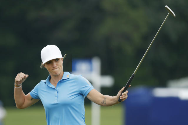Mel Reid, of England, reacts after making her birdie putt on the 18th green during the final round of the KPMG Women's PGA Championship golf tournament, Sunday, June 23, 2019, in Chaska, Minn. (AP Photo/Charlie Neibergall)