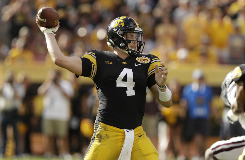 Iowa quarterback Nate Stanley throws a pass against Mississippi State during the second half of the Outback Bowl NCAA college football game Tuesday, Jan. 1, 2019, in Tampa, Fla. (AP Photo/Chris O'Meara)