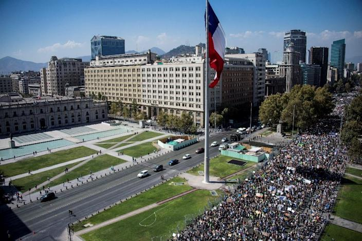 Thousands demonstrated in front of La Moneda presidencial palace in Santiago, Chile during the global protests (AFP Photo/Martin BERNETTI)