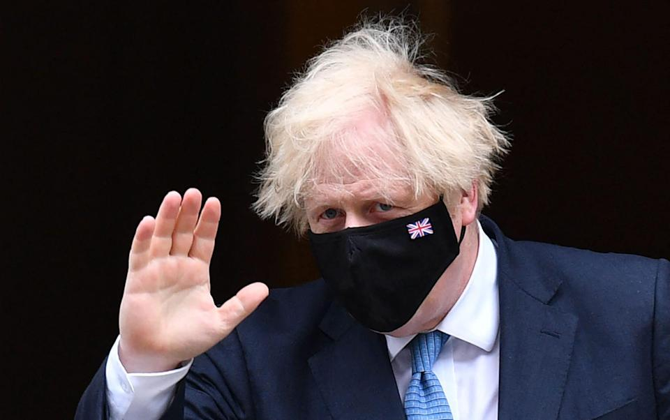 Boris Johnson announced on Monday that he would change the law to require proof of two doses of a Covid vaccine for entry into nightclubs - Justin Tallis/AFP via Getty Images