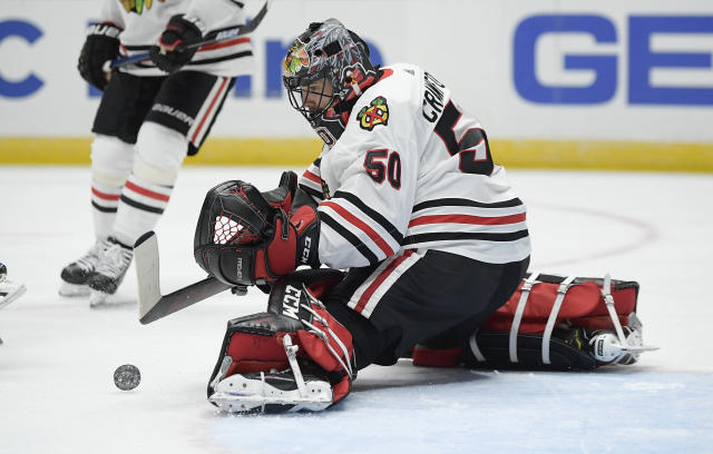Chicago Blackhawks goaltender Corey Crawford stops a shot during the second period of the team's NHL hockey game against the Anaheim Ducks on Wednesday, Feb. 27, 2019, in Anaheim, Calif. (AP Photo/Mark J. Terrill)