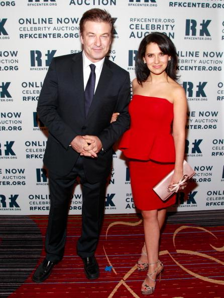 """Photo by: Getty Images Hilaria Thomas and Alec BaldwinThomas and Baldwin ranked #2 on Huffington Post's 2012 Best Dressed Newylyweds. The """"30 Rock"""" actor, seen here in a sharp suit, and his Spanish wife in Oscar de la Renta, express an effortless style."""