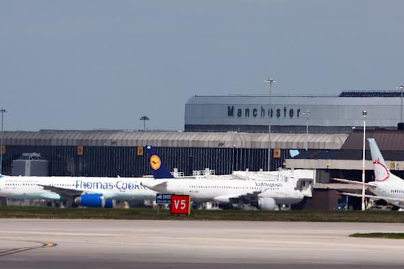 Cleaner risks life by running across tarmac used by planes at Manchester Airport
