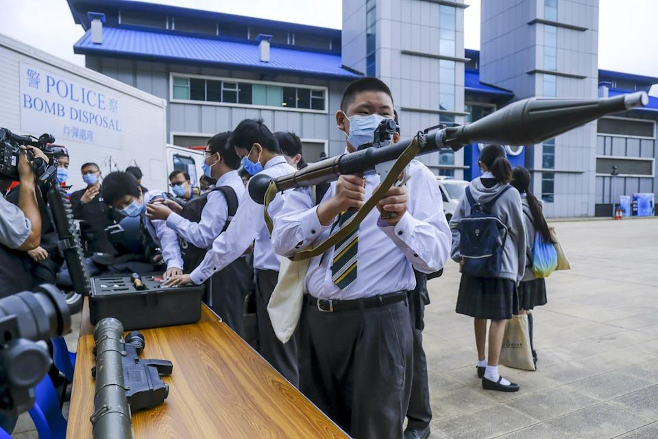 Pupils had the chance to pick up weapons during National Security Education Day. Photo: Bloomberg