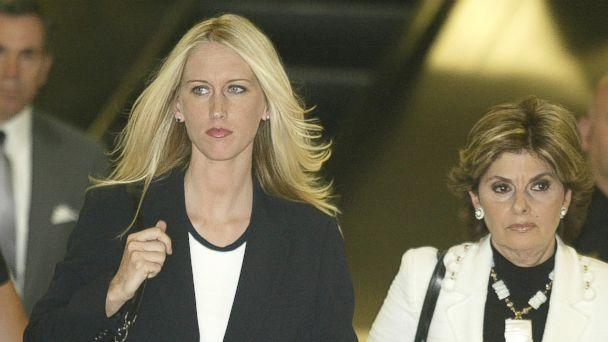 PHOTO: Amber Frey, left, leaves the San Mateo County Courthouse flanked by her lawyer Gloria Allred after Frey's second day of testimony in the Scott Peterson double murder trial on Aug. 11, 2004 in San Mateo, Calif. (Lou Dematteis/Getty Images)