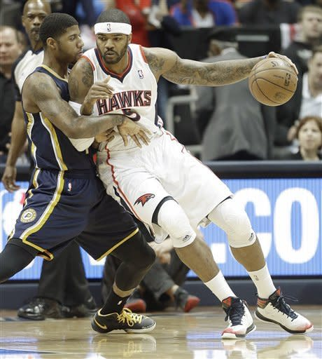 Atlanta Hawks small forward Josh Smith (5) moves the ball against Indiana Pacers small forward Paul George (24) during the first half in Game 3 of their first-round NBA basketball playoff series, Saturday, April 27, 2013 in Atlanta. (AP Photo/John Bazemore)