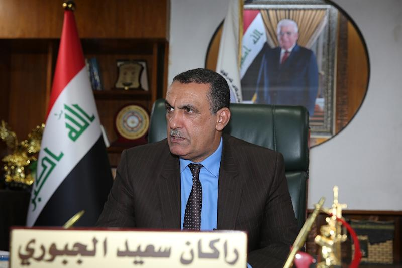 Rakan Said al-Juburi, the Sunni Arab interim governor of the oil-rich Iraqi Kirkuk province and candidate for the May 12 parliamentary polls, speaks with AFP during an interview in his office in the northern city of the same name on April 30, 2018 (AFP Photo/SABAH ARAR)