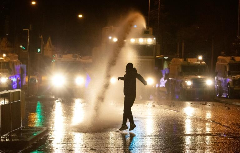 Masked and in hooded tops, rioters hurled rocks, bricks and glass bottles at police barricades