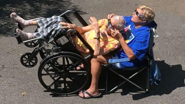 PHOTO: Hedy Morrison of Nashville, Tenn., helped her elderly father witness the total solar eclipse while tilting his wheelchair back. (Courtesy of Molly Morrison)