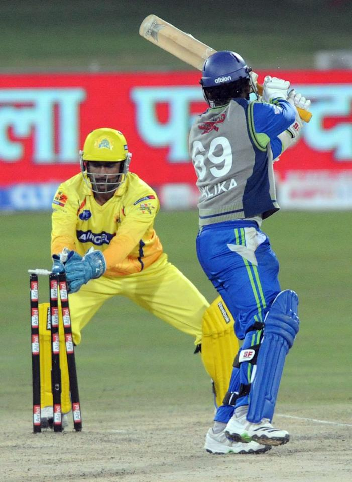 CENTURION, SOUTH AFRICA - SEPTEMBER 15:  Shalika Karunanayake (R) of Wayamba Elevens is stumped by MS Dhoni of Chennai Super Kings during the Airtel Champions League Twenty20 match between Chennai Super Kings and Wayamba Elevens at SuperSport Park on September 15, 2010 in Centurion, South Africa. (Photo by Lee Warren/Gallo Images/Getty Images)