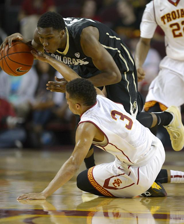 Colorado guard Jaron Hopkins, top, and Southern California guard Chass Bryan go after a loose ball during the first half of an NCAA college basketball game, Sunday, Feb. 16, 2014, Los Angeles. (AP Photo/Mark J. Terrill)