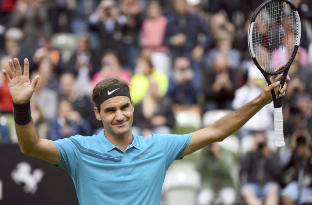 Roger Federer celebrates as he defeats Mischa Zverev during the ATP Mercedes Cup tournament in Stuttgart, Germany, Wednesday, June 13, 2018. (Marijan Murat/dpa via AP)