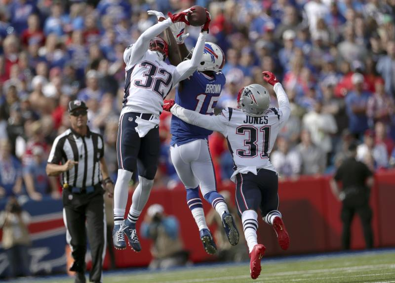 New England Patriots safety Devin McCourty, No. 32, pulls in a first-quarter interception against the Buffalo Bills on Sunday. (AP)