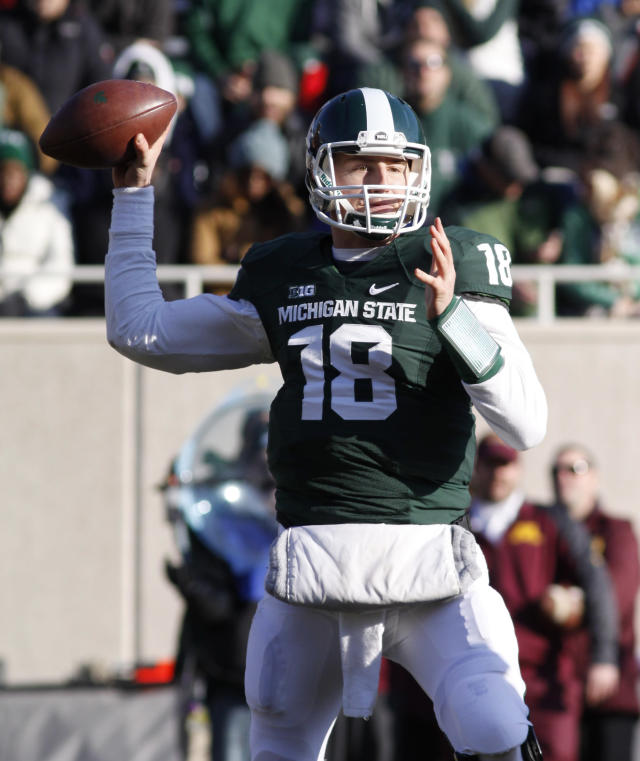 Michigan State quarterback Connor Cook throws a pass during the third quarter of an NCAA college football game against Minnesota, Saturday, Nov. 30, 2013, in East Lansing, Mich. Michigan State won 14-3. (AP Photo/Al Goldis)
