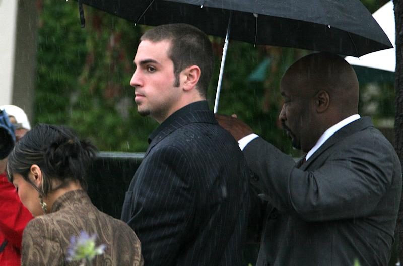 FILE - In this May 5, 2005 file photo, defense witness Wade Robson, center, along with an unidentified woman, is escorted into the Santa Barbara County Courthouse by a member of Michael Jackson's security force, in Santa Maria, Calif. to provide testimony in Jackson's trial on charges of child molestation. Robson, a choreographer who testified that Michael Jackson never abused him as a child, has now filed a claim against the singer's estate claiming years of abuse at by the pop superstar. Robson's attorney Henry Gradstein writes in a statement that his client was abused by the pop superstar over a seven year period.  (AP Photo/Michael A. Mariant, File)