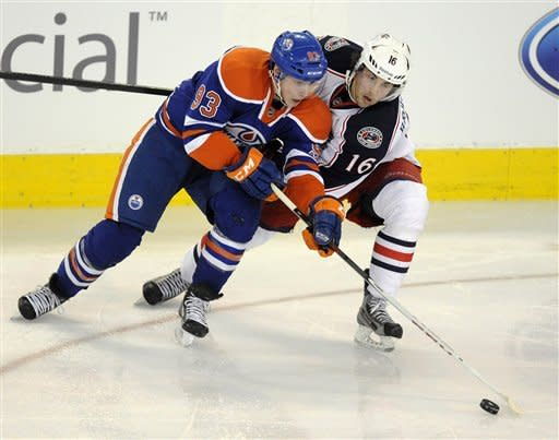 Columbus Blue Jackets' Kristian Huselius, right, battles with Edmonton Oilers' Ryan Nugent-Hopkins during the second period of an NHL hockey game Wednesday, March 14, 2012, in Edmonton, Alberta. (AP Photo/The Canadian Press, John Ulan)