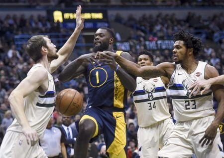 Mar 2, 2018; Milwaukee, WI, USA; Milwaukee Bucks center Tyler Zeller (44) and guard Sterling Brown (23) puts pressure on Indiana Pacers guard Lance Stephenson (1) in the second quarter at the BMO Harris Bradley Center. Mandatory Credit: Benny Sieu-USA TODAY Sports