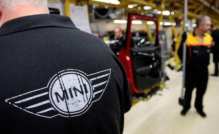 FILE PHOTO: Workers assemble cars at the plant for the Mini range of cars in Cowley