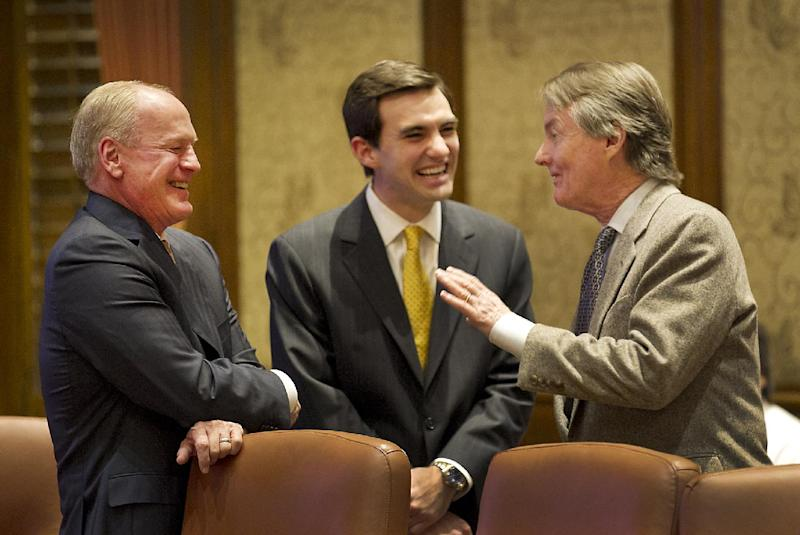 """University of Texas at Austin President Bill Powers, right, talks with Regents R. Steven Hicks, left, and Student Regent Nash M. Horne, center, before the start of the UT System Board of Regents meeting Thursday morning, Dec. 12, 2013.The board was scheduled to discuss an unspecified """"recommendation"""" about the employment of Powers. Powers is popular on the UT campus he's led since 2006, but his vision for higher education has clashed with some regents and Gov. Rick Perry. (AP Photo/Austin American-Statesman, Ralph Barrera) AUSTIN CHRONICLE OUT, COMMUNITY IMPACT OUT, INTERNET MUST CREDIT PHOTOGRAPHER AND STATESMAN.COM"""