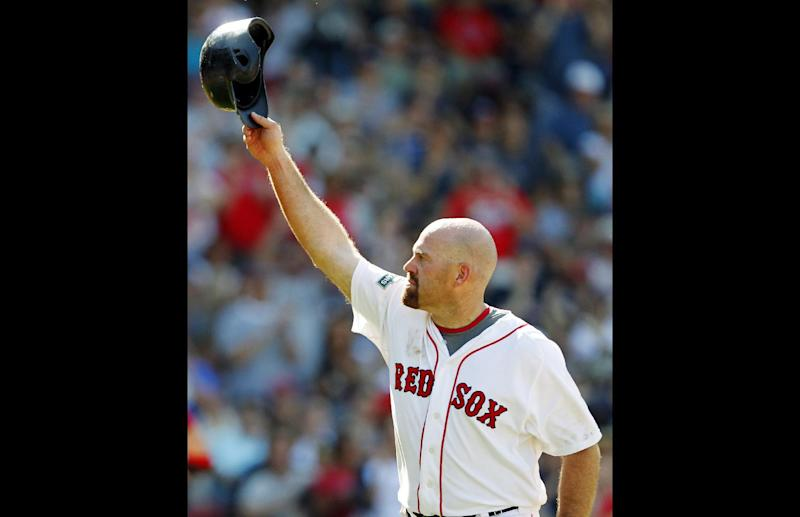 FILE - In this June 24, 2012, file photo, Boston Red Sox's Kevin Youkilis tips his helmet as he comes off the field after hitting a triple and being replaced with a pinch runner in the seventh inning of a baseball game against the Atlanta Braves in Boston. A person familiar with the negotiations told The Associated Press Tuesday, Dec. 11, that free agent Youkilis and the New York Yankees have reached agreement on a $12 million, one-year deal. (AP Photo/Michael Dwyer, File)