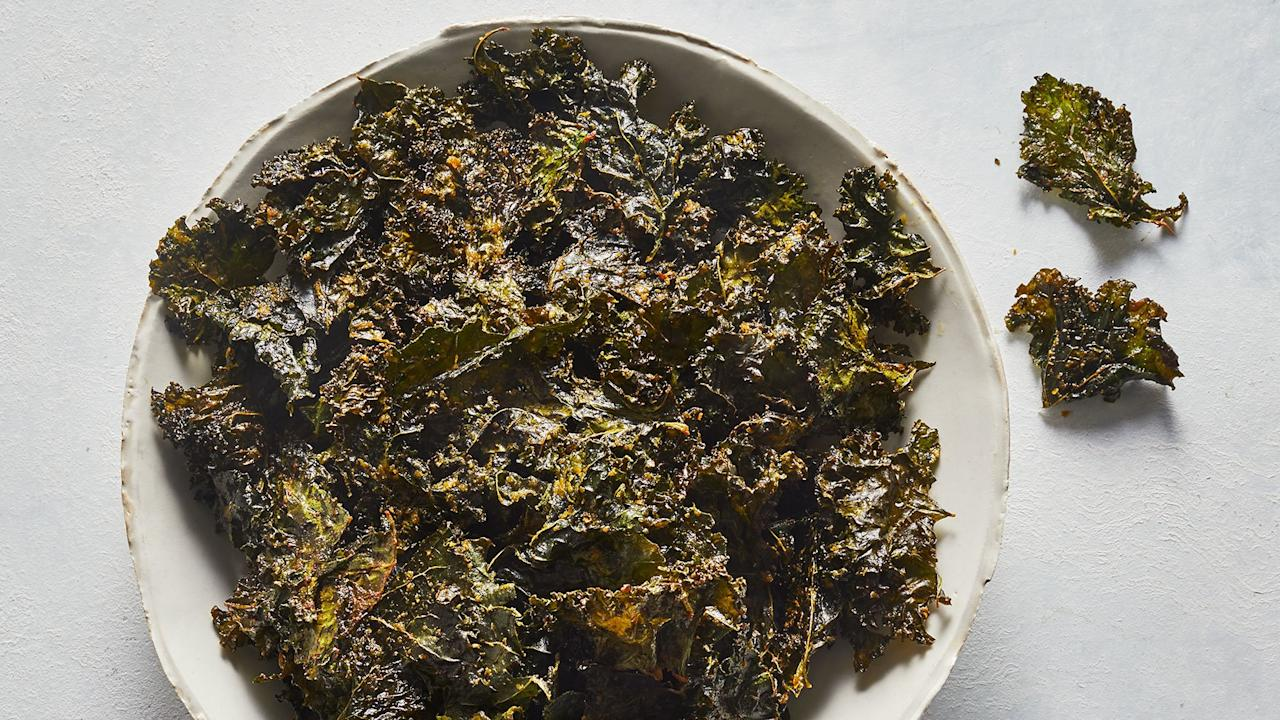 """<p>Yes, there's yet another use for kale. Turn this leafy green into a tasty snack with nutritional yeast and a few other spices: You can nibble and make good, nutritional choices at the same time.</p> <p><strong>Get the recipe: </strong><a href=""""https://www.realsimple.com/food-recipes/browse-all-recipes/kale-chips-recipe"""" target=""""_blank"""">Smoky Kale Chips</a></p>"""