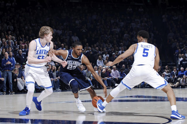 "Villanova's <a class=""link rapid-noclick-resp"" href=""/ncaab/players/126421/"" data-ylk=""slk:Mikal Bridges"">Mikal Bridges</a> drives against Xavier's J.P. Macura and <a class=""link rapid-noclick-resp"" href=""/ncaab/players/126244/"" data-ylk=""slk:Trevon Bluiett"">Trevon Bluiett</a>. (Getty)"