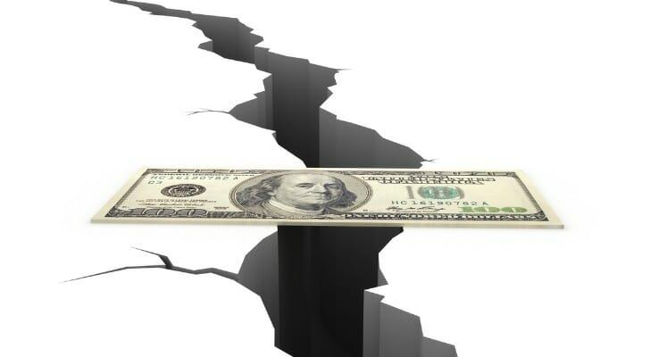 PIcture of a $100 bill as a bridge over a chasm