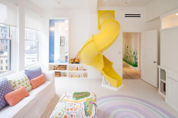 "<p>One surefire way to make sure your home has the coolest playroom on the block? Build an indoor curly slide. When it's too cold to go to the park during the winter, your kids will still be able to slide all day long. Plus, it's visually unexpected, which gives the room an edge. No need to wait in a line at Six Flags ever again. We're also digging the whimsical upholstery on the ottoman in this playroom by <a href=""http://www.studiodb.com/"" rel=""nofollow noopener"" target=""_blank"" data-ylk=""slk:Studio DB"" class=""link rapid-noclick-resp"">Studio DB</a>. </p>"