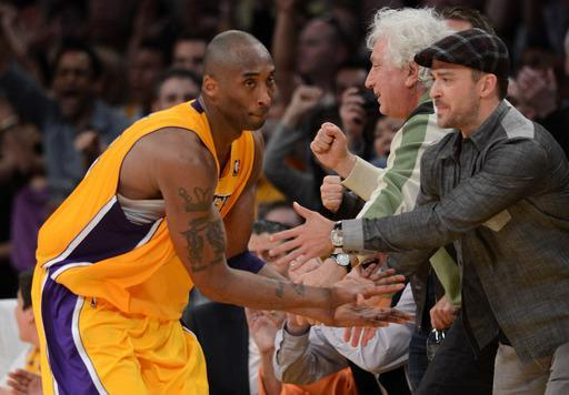 LOS ANGELES, CA - MAY 12: Kobe Bryant #24 of the Los Angeles Lakers reacts with Justin Timberlake after Bryant makes a basket in the fourth quarter against the Denver Nuggets in Game Seven of the Western Conference Quarterfinals in the 2012 NBA Playoffs on May 12, 2012 at Staples Center in Los Angeles, California. (Photo by Harry How/Getty Images)