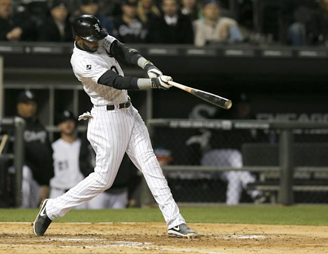Chicago White Sox's Alexei Ramirez hits an RBI triple off Tampa Bay Rays starting pitcher Jake Odorizzi, scoring Dayan Viciedo, during the fourth inning of a baseball game Monday, April 28, 2014, in Chicago. (AP Photo/Charles Rex Arbogast)