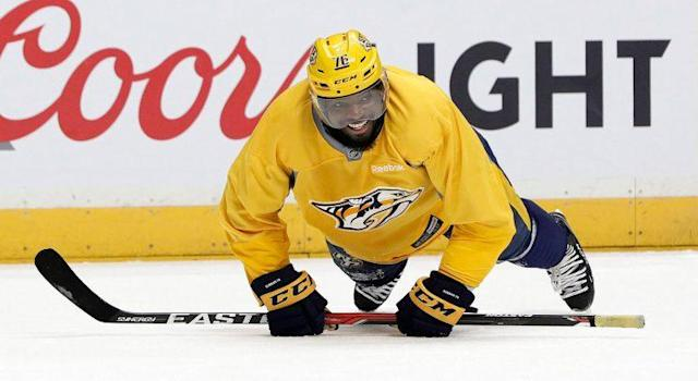 "<a class=""link rapid-noclick-resp"" href=""/nhl/teams/nas/"" data-ylk=""slk:Nashville Predators"">Nashville Predators</a> defenseman <a class=""link rapid-noclick-resp"" href=""/nhl/players/4558/"" data-ylk=""slk:P.K. Subban"">P.K. Subban</a> does pushups during practice. (Mark Humphrey/AP)"