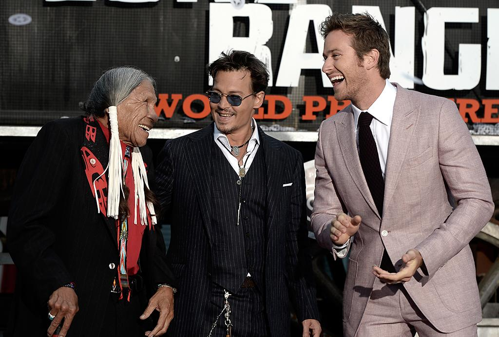 """ANAHEIM, CA - JUNE 22:  Actors Saginaw Grant, Johnny Depp, and Armie Hammer arrive at the premiere of Walt Disney Pictures' """"The Lone Ranger"""" at Disney California Adventure Park on June 22, 2013 in Anaheim, California.  (Photo by Kevin Winter/Getty Images)"""